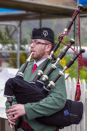 GLENFINNAN, LOCHABER/SCOTLAND - MAY 19 : Piper from the Lochaber Pipe Band at Glenfinnan in the Highlands of Scotland on May 19, 2011. Unidentified man