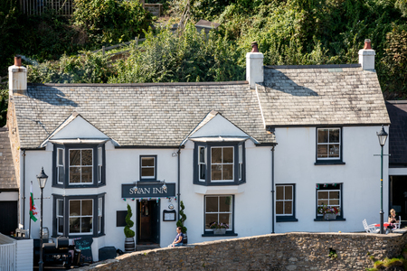 LITTLE HAVEN, PEMBROKESHIRE/UK - SEPTEMBER 14 : View of the Swan Inn at Little Haven Pembrokeshire on September 14, 2019. Two unidentified people