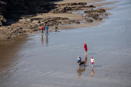 LITTLE HAVEN, PEMBROKESHIRE/UK - SEPTEMBER 14 : People walking on the beach at Little Haven Pembrokeshire on September 14, 2019. Unidentified people