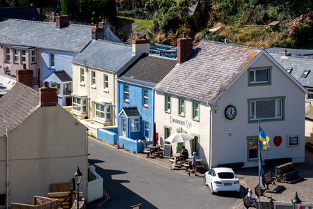 LITTLE HAVEN, PEMBROKESHIRE/UK - SEPTEMBER 14 : View of the village of Little Haven Pembrokeshire on September 14, 2019. Three unidentified people