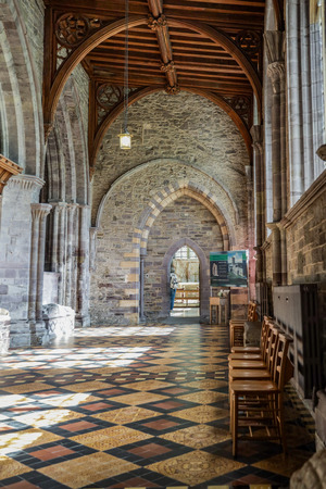 ST DAVID'S, PEMBROKESHIRE/UK - SEPTEMBER 13 : Interior iew of the Cathedral at St David's in Pembrokeshire on September13, 2019. One unidentified person Éditoriale