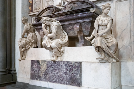 FLORENCE, TUSCANYITALY - OCTOBER 19 : Monument to Michelangelo di Lodovico Buonarroti Simoni in Santa Croce Church in Florence on October 19, 2019