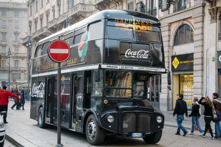 MILAN, LOMBARDY, ITALY - FEBRUARY 23 : Coca Cola double decker bus in Milan on February 23, 2008. Unidentified people
