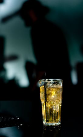 barkeep: A drink with the bartender in sillouette Stock Photo