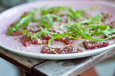 Carpaccio with sallad and parmesan cheese