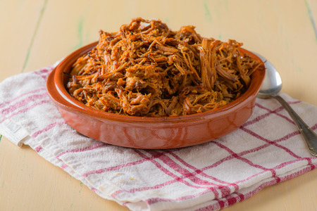 barbecue pork barbecue: Plate filled with pulled pork on a round dish Stock Photo