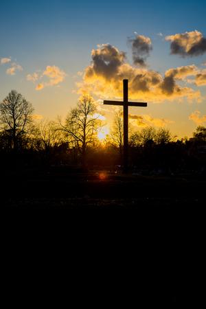 Christian cross in the sunset