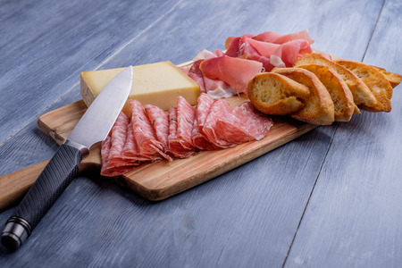 Antipasto plate with cheese salami and ham photo