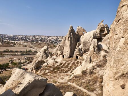 Remains of rock-cut christian temples at the rock site of Cappadocia near Goreme, Turkey. Fairy chimneys in Cappadocia. Spectacular volcanic rock formations.