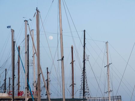 Full moon between masts of nautical vessels with Turkish and St.Andrew flag.