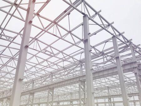 Metal frame of prefabricated multi-storey building. Metal pillars, beams and diagonal bracings Standard-Bild