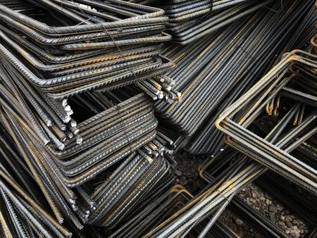 Piled iron reinforcement workpieces. Bent metal parts for reinforcement.