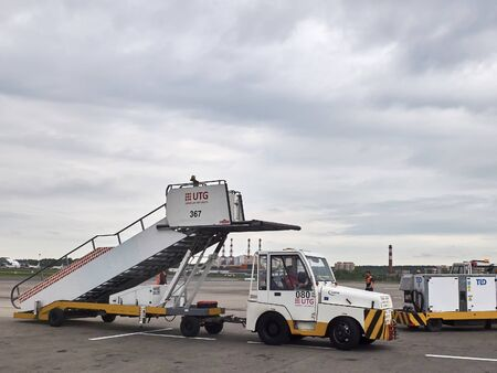 The airport car transports the plane ladder on the airfield. Vnukovo airport, Moscow - May 2019.