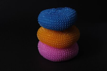 Set of colorful dish washing sponges at black background.
