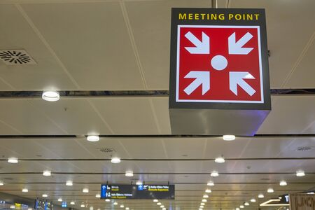 Meeting point sign at the airport hall