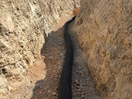 The high voltage electrical cable is laid in a trench