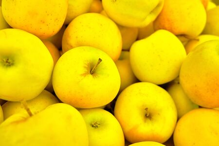 yellow apples on the market background or texture. Stock Photo
