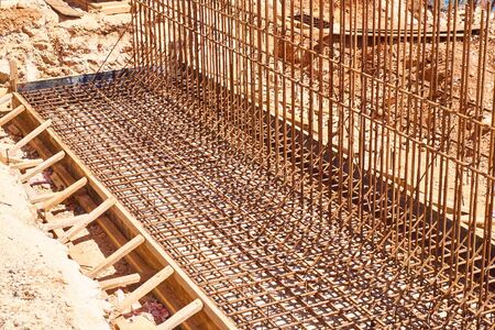 Metal reinforcement framework and formwork of retaining wall.