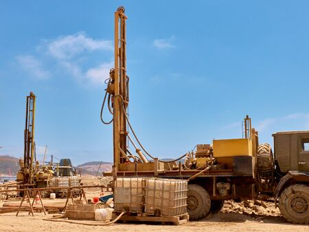 Mobile drilling rigs on vehicles at construction site. 写真素材