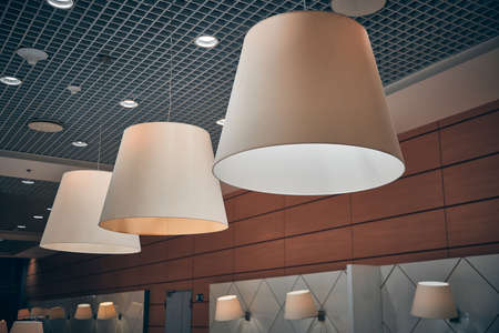 Lamps in conical shades in cafe at airport