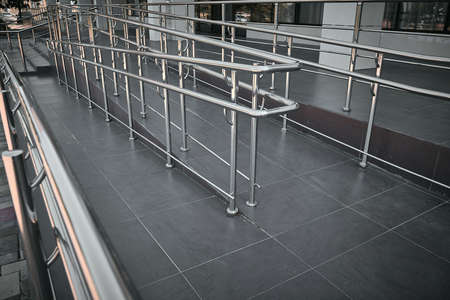 Ramp for people with disabilities and chrome railings.