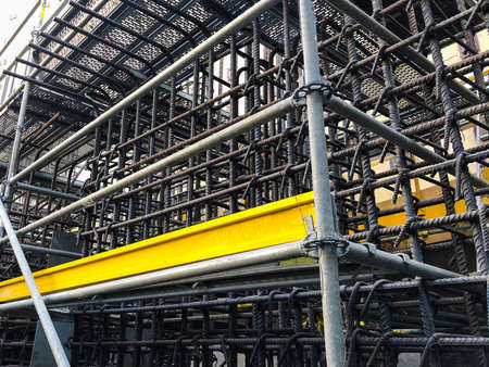 Metal reinforcement framework and scaffoldings at construction site.