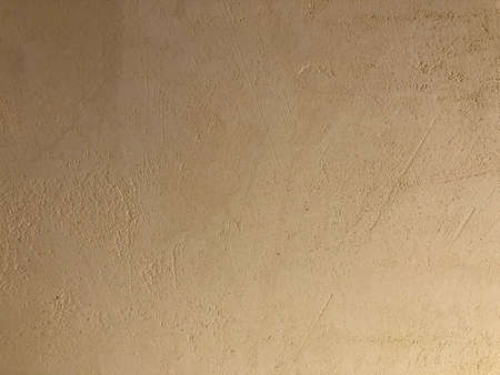 Plastered grinded textured wall. Abstract texture background.