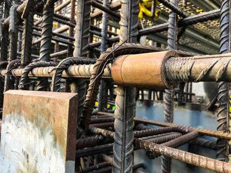 Metal threaded couplings connecting reinforcing rebars. Reinforcement framework.