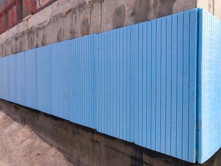Waterproofing and thermal insulation of concrete building walls. Standard-Bild