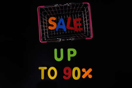 Black friday concept. Sale up to 90 per cent. Shopping basket at black