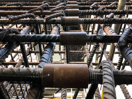 Metal threaded couplings connecting reinforcing rebars. Reinforcement framework