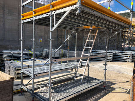 Scaffoldings at construction site. Auxillary construction equipment. High quality photo Archivio Fotografico