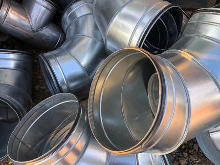 Halvanized ventilation pipe elbows. Industrial metal pipes.