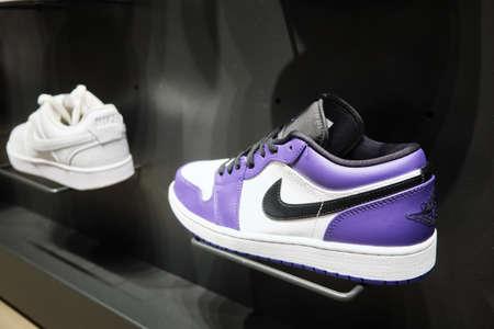 Nike Air Jordan 1 Low Court Purple colorway sneakers at retail store display. Mersin, Turkey - November 2020