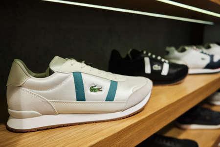 Lacoste Partner Retro sneakers at shelf of store. Mersin, Turkey - November 2020