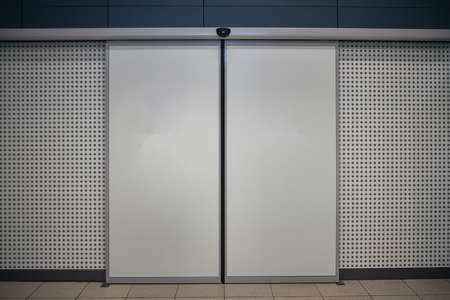Blank automatic entrance doors with motion sensor at public place Stock Photo