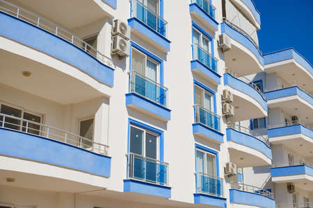 Blue and white multi storey residential building. Modern apartment building
