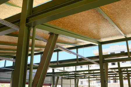 Metal framework of hangar. Metal supporting structures. Beams and girders of truss ceiling