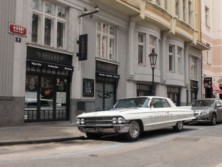 Old time Cadillac Coupe De Ville in street of Prague Editorial