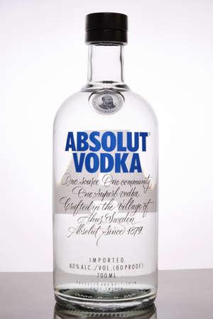 Bottle of Absolut Vodka against light background with back lighting
