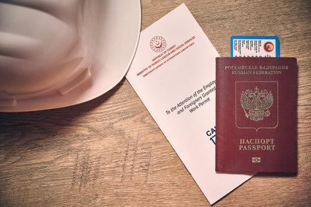 White hardhat, russian foreign passport and turkish work permit Stock Photo