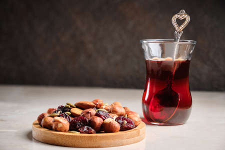Turkish tea and nut mix at table