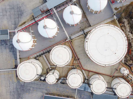 Storage tanks for liquefied natural gas top down aerial view Stock Photo