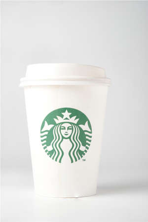 Starbucks Coffee paper cup with coffee stains