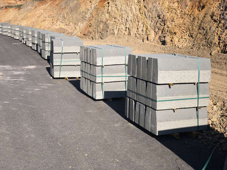 Stacked curbstones at road construction site