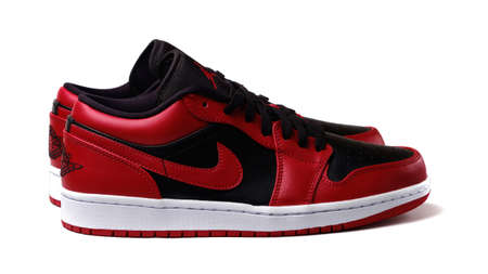 Nike Air Jordan 1 Retro Low Reverse Bred colorway sneakers isolated on white illustrative editorial Editorial