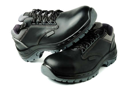 Black leather work safety boots isolated on white