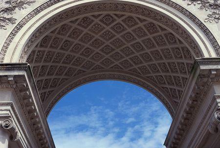 Arch against blue sky.