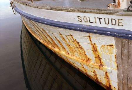 SOLITUDE on the hull of a boat.