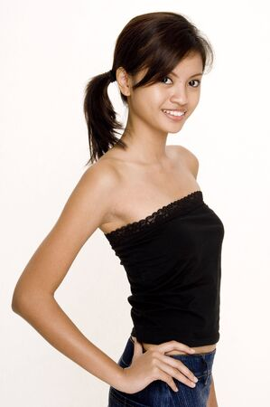 tube top: A young attractive asian woman in a black tube top Stock Photo
